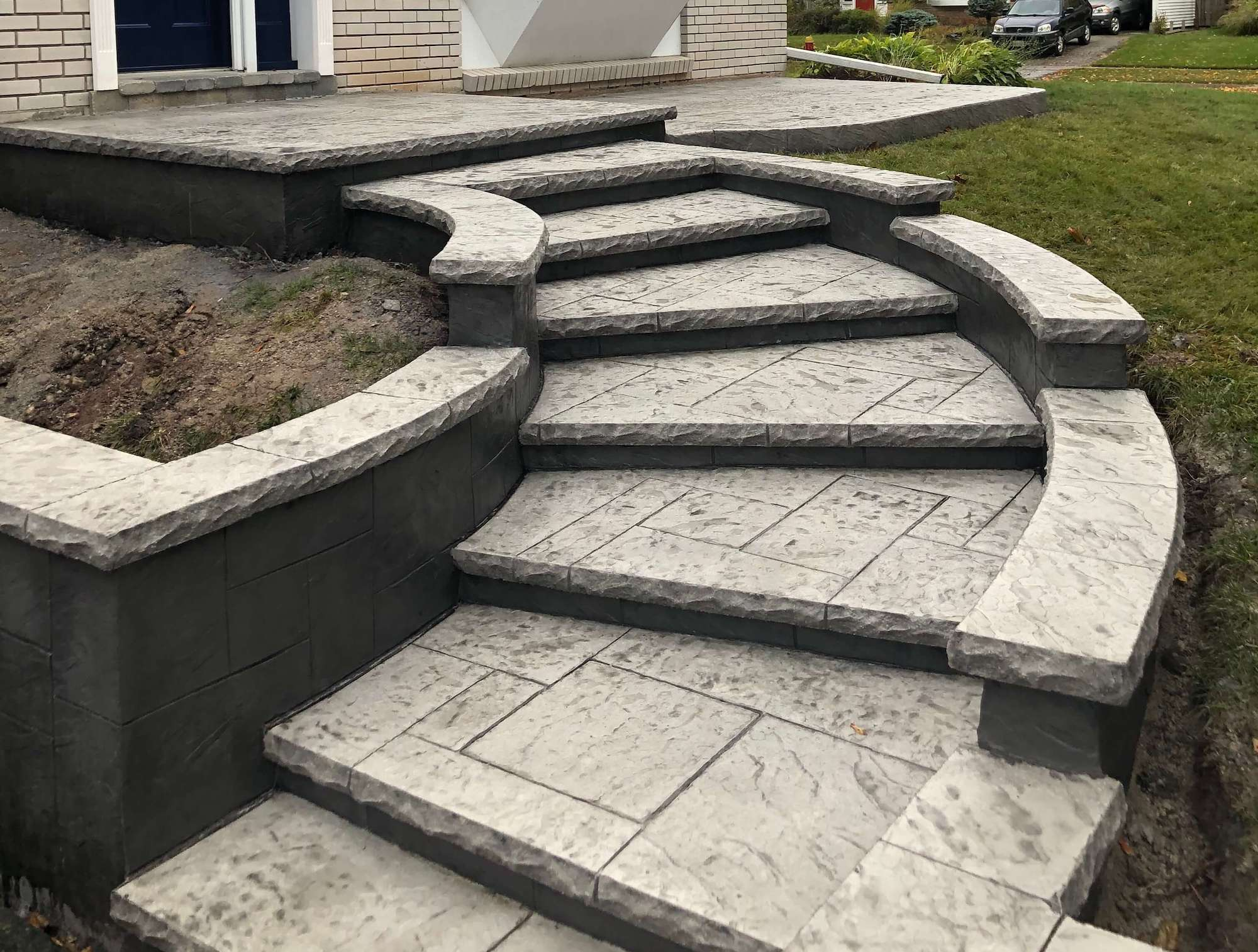 Curved Yorkstone Staircase with Retaining walls. Stone Gray with Classic Gray